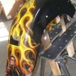 Johnny Cash giving the famous salute on the back fender in amidst the fire. 3 of 4